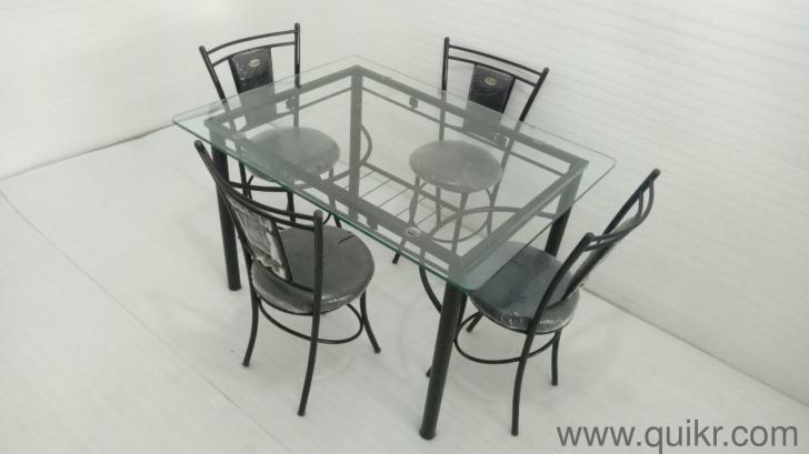 4 Seater Glass Top Dining Table For Sale By Quikr Certified