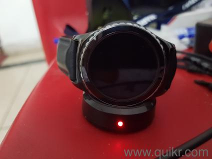 Samsung Gear S2 smartwatch with wireless charger