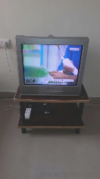 21 inch Sony Trinitron color TV with TV stand, good picture