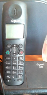 Two cordless phone one table phone