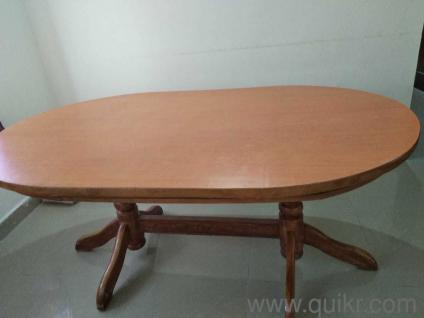 Wooden Dining table with 6 Chairs. Selling it because moving out of ...