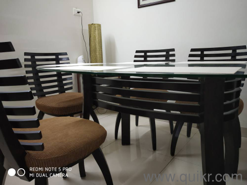 6 seater Dining table with glass top and commercial ply ...
