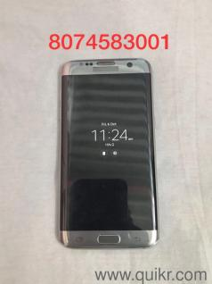 Samsung galaxy S7 edge 32GB Dual sim UAE bought with new wireless charger  Mobile used only for 7 month no scratches with original cover with all
