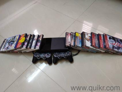 PS2 With over 10 games with 2 joysticks and a memory card