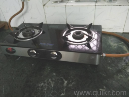 47687a92dbe House Shifting Sale - Gas Stove - Surya Flame 2 burner glass top 1.5 yrs old
