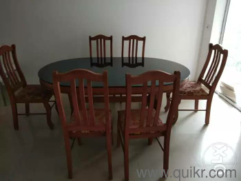 Teak wood black glass top dining table with 6 chairs